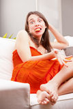 Funny face girl eating caught eating cookies Stock Image