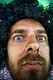 Funny face - Goofy man with curly wig stock images