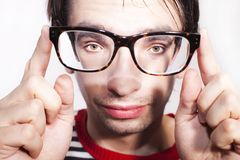 Funny face guy with glasses. Close-up Stock Photos
