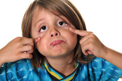 Funny face kid eyes. Shot of funny face kid eyes Stock Photography