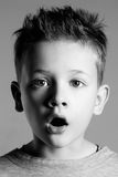 Funny face of kid.handsome little boy. Black and white portrait.funny face of kid.handsome little boy. 7 years old child royalty free stock photos