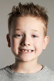 Funny face of kid.smiling handsome little boy Stock Image