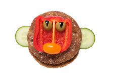 Funny face made of black bread and vegetables Royalty Free Stock Images