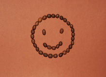 Funny face made of coffee beans Royalty Free Stock Photos