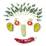 Funny face made of different vegetables stock images