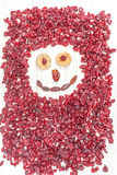 Funny face made of dried fruits on white wooden background Stock Photos