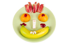 Funny face made of fruits Stock Photos