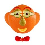 Funny face made of orange and fruits Royalty Free Stock Photo
