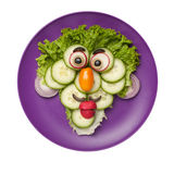 Funny face made of vegetables Stock Photos