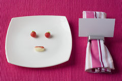 Funny face plate Royalty Free Stock Image