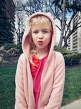 Girl child making funny silly faces with duck lips. stock images