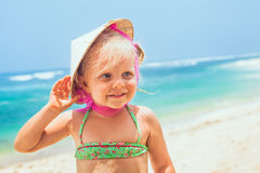 Funny face portrait of happy child in vietnamese straw hat Royalty Free Stock Image