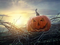 Funny face pumpkin sitting on fence Royalty Free Stock Image