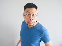 Funny face of shocked Asian man. stock photography