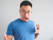 Funny face of shocked Asian man. Royalty Free Stock Image