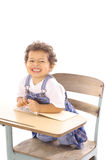 Funny face toddler in a desk Royalty Free Stock Images