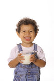 Funny face toddler with glass of milk. Shot of a funny face toddler with glass of milk Stock Image