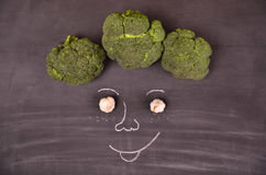 Funny face from vegetables on black ground Royalty Free Stock Photo