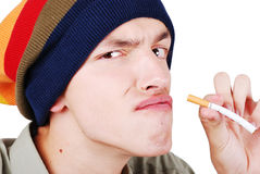 Funny face young man with cigarete Royalty Free Stock Photography