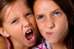 Funny faces. Two pretty young girls making funny faces Royalty Free Stock Image