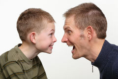 Funny faces. Closeup of father and child making funny faces at each other Stock Images