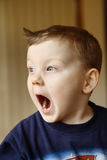 Funny Faces. Three year old boy pulling funny faces Stock Photos