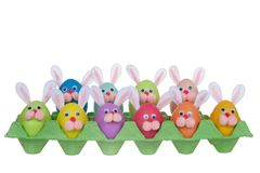 Funny faces bunny easter eggs in an egg carton stock photos