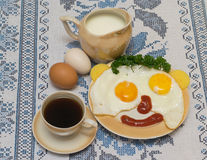 Funny faces from eggs with cheese and sauce Royalty Free Stock Images