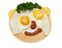 Funny faces from eggs with cheese and sauce isolated Stock Photography