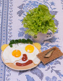 Funny faces from eggs with cheese and sauce Stock Photo