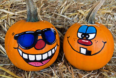 Funny Faces Painted On Pumpkins Stock Photography