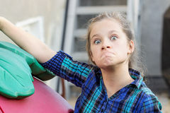 Funny faces. A young girl making funny faces Stock Images