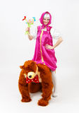 Funny fairy tale girl sitting upwards a man in costume of bear Stock Photo