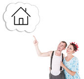 Funny family couple embracing and pointing on dream house Stock Photos