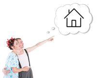 Funny family couple embracing and pointing on dream house Stock Photo