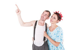 Funny family couple embracing and pointing up Stock Photos