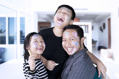 Funny family with crayons at home Royalty Free Stock Image