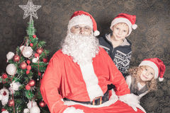 Funny family, happy kids and Santa Claus Stock Images