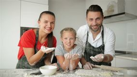 Funny Family Having Fun In The Kitchen. They Blow The Flour From Their Hands. It Looks So Cute. HD, Together, Indoors, Three, Happy stock footage