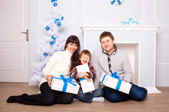 Funny family holding gifts. Christmas concept. Royalty Free Stock Photography