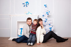 Funny family hugging near the fireplace Royalty Free Stock Images