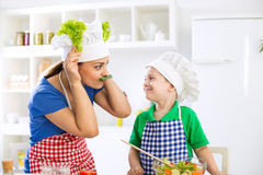 Funny family moments in kitchen Royalty Free Stock Photography