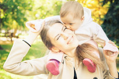 Funny family - mother with her baby outdoor at autumn park Stock Photo
