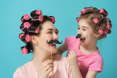 Mother and her daughter with a paper accessories Royalty Free Stock Photography