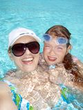 Funny family in the pool. Mother and child funny swimming in a pool stock images