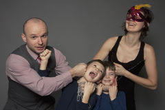 Funny family portrait. Funny portrait of young happy family Royalty Free Stock Photos