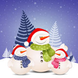 Funny family of snowman at Christmas Royalty Free Stock Images