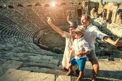 Funny family take a self photo in amphitheatre building.Side,Turkey Stock Photo