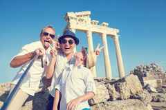 Funny family take a selfie photo on Apollo Temple colonnade view. In Side, Turkey stock photo