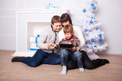 Funny family using the tablet Stock Photography